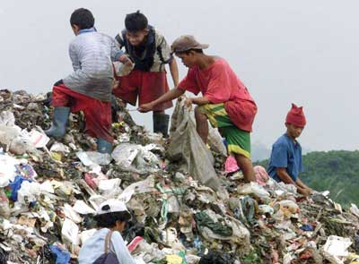 Turning a Mountain of Garbage into a Monument of Hope: What does a busy New York priest have to do with a slum in the Philippines? by Patricia Mitchell